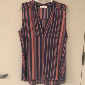 Striped sleeveless blouse.
